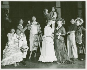 [Pat Stanley (Carrie Pipperidge), Russell Nype (Enoch Snow), Leo Lucker (Heavenly friend), Victor Moore (Starkeeper), Bambi Linn (Louise), Robert Pagent (Carnival boy), Barbara Cook (Julie Jordan), Marie Powers (Nettie Fowler), James Mitchell (Jigger Craigin) and Kay Medford (Mrs. Mullin) in the 1957 revival of Carousel]