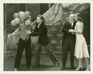[Joseph Macaulay (Tony), Austin Marshall (Phil Barker), George M. Cohan (President) and Joy Hodges (Peggy Jones) in I'd Rather Be Right]