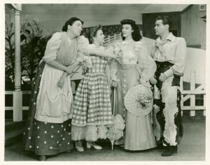 [Betty Garde (Aunt Eller), Joan Roberts (Laurey), Jane Lawrence Smith (Gertie) and Alfred Drake (Curly) in Oklahoma!]