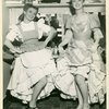 Joan Roberts (Laurey) and Celeste Holm (Ado Annie) backstage at Oklahoma!]