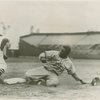 Jackie Robinson sliding into home as a member of the Montreal Royals, the Brooklyn Dodgers farm club