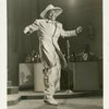 Cab Calloway in zoot suit, performing on stage.