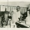 Scientist George Washington Carver in his laboratory at Tuskegee Institute, Alabama.