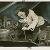 Mrs. Peggy Hargett of Pioneer Auto Repair, working on an automobile