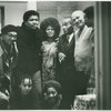 Group portrait of (left to right): Bob Rogers, Ishmael Reed, Jayne Cortez, Léon-Gontran Damas, Romare Bearden, Larry Neal; seated: Nikki Giovanni and Evelyn Neal, in New York City, 1969
