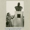 Mrs. A. Jacques Garvey viewing the bust of Marcus Garvey