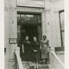 Amy Ashwood Garvey with two unidentified women on the steps of the Afro Women's Centre