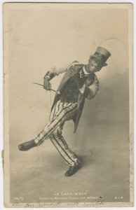 "Le Cake-Walk.""Danse au Nouveau Cirque, LES NEGRES."" Photo postcard of man dancing with top hat and cane."