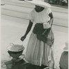 Woman vendor preparing food on a coal pot