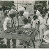 Market scene, man selling vegetables