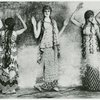 [Stylized photo shot through gauze with manipulation of negative to achieve a flat, painted frieze-like effect of a line of female dancers in nymph costumes in Nijinsky's ballet.]