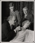 Jerome Dempsey, Valerie Mahaffey, Alan Coates and Dillon Evans in the 1977-80 Broadway revival of Dracula, sets by Edward Gorey