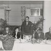 Carlton Moss (standing) addressing armed forces servicemen and women at annual Thanksgiving Dinner