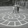 Location scouting contact sheets. Three children on an asphalt playground