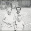 Location scouting contact sheets. Close up of three children on playground