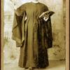 Rev. Mrs. J. H. Vigal of Buffalo, N.Y., arm raised, holding Bible.