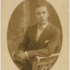 George Westerman seated in chair.