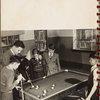 man teaching boys to play billiards]