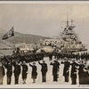"[The armored cruiser ""Admiral Graf Spee"" leaves for its Atlantic voyage from the harbor of Ceuta in Spanish Morocco: The Falangists salute the armored cruiser ""Admiral Graf Spee"" and her crew.]"