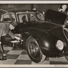 One of the most admired cars at the Automobile Show is the streamlined Horch V930.  It is equipped with a fold-out wash basin on the side.]