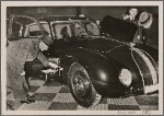 One of the most admired cars at the Automobile Show is the streamlined Horch V930.  It is equipped with a fold-out wash basin on the side.