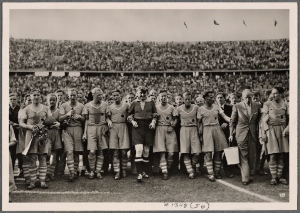 [The outbreak of war has not disrupted the peaceful life of the Reich.  In the packed Olympic Stadium the finals of the German soccer championship took place.  Schalke were the champions again.]
