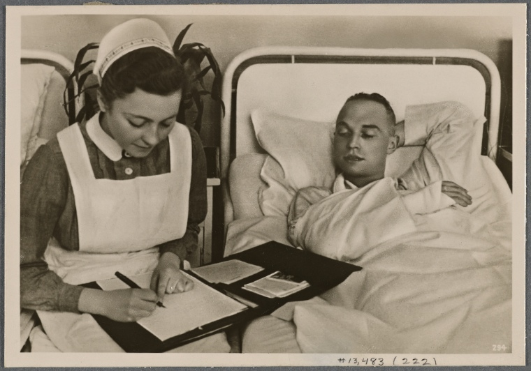 [Because the wounded one's hand cannot do so, the nurse from the German Red Cross writes a letter to his parents and wife.  In a thousand small ways the homeland shows its thanks to its soldiers.]