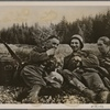 But Christmas didn't make the duty of protecting the Reich any easier.  It's a difficult trip for the men carrying the heavy ration cans up to the forward positions.  They take a break just long enough to smoke a cigarette.]