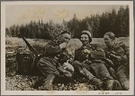 But Christmas didn't make the duty of protecting the Reich any easier.  It's a difficult trip for the men carrying the heavy ration cans up to the forward positions.  They take a break just long enough to smoke a cigarette.