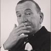 """[Noël Coward in a publicity photograph for his """"Nude With Violin.""""]"""