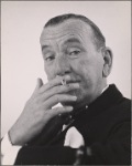 """Noël Coward in a publicity photograph for his """"Nude With Violin."""""""