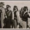 Chief of Staff Lutze visits the new Italian settlements in Libya. The Chief of Staff and His Excellency Russo inspect ranks of Askaris (native soldiers) in Nalut.]