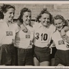 Four women athletes of the Hamburg Athletics Club who won the 4 x 100 meter relay in the war competition of German Sports, Olympic Stadium, Berlin.]