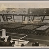 "On May 1st, the National Holiday of the German People, the Fuhrer spoke to his youth in the Berlin Olympic Stadium.  The dark jackets of the BdM between the white blouses spell out the words ""We belong to you"".]"