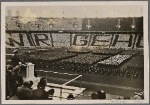 "On May 1st, the National Holiday of the German People, the Fuhrer spoke to his youth in the Berlin Olympic Stadium.  The dark jackets of the BdM between the white blouses spell out the words ""We belong to you""."