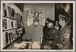 Il Duce visits the German Book Exposition in the Mercati Trajani in Rome.  Landesgruppenleiter Ettel explains to Mussolini some particular works representative of German literature.
