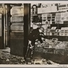 England has begun to experience anxious days because of bomb attacks by the Irish Republican Army.  Our picture shows a shop badly damaged by a bomb.]