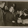 [The Fuhrer, along with Reich Labor Front leader Dr. Ley, met with the outstanding men and women armaments workers who had received the War Merit Cross and thanked them for their efforts.]