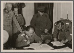 "The entry of the Red Army into the Ukrainian and White Russian districts of Poland gave England and her allies an unpleasant surprise and left her ""Ministry of Lies"" unable to do anything but issue angry statements.  Our picture shows a German army commander with Russian officers in the former Voivodeschaft (district) of Bialystok during discussions concerning the placement of the agreed (German-Russian) demarcation line."