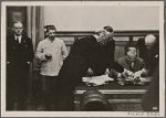 [The Berlin-Moscow non-aggression pact was signed by Reich Foreign Minister von Ribbentrop and Russian Foreign Minister Molotov.  Our picture shows Foreign Minister Molotov signing the pact.  At left, Reich Foreign Minister von Ribbentrop, Herr Stalin, Under Secretary of State Gauss, Counsellor Hilger and Ambassador Count  von der Schulenburg.]