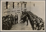 [The movement in the Ostmark (Austria) honors the sacrifice made for the sake of a Greater Germany by those who were sentenced to hang for their part in the July Insurrection.  Our picture shows wreaths being laid at the three pylons marking the spot where the fighters sentenced by the Vienna District Court met their death on the gallows.]