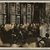 In a festive ceremony, Reichs Interior Minister Dr. Frick swore in District Leader Greiser as Reichs Governor of the Warthe District (part of occupied Poland).  District Leader Greiser delivered an address in the old throne room of Posen Castle.]
