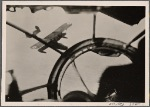 """All the way to the Shetland Islands the German Air Force hunts the enemy.  Here is an actual shot from a battle between a German plane and an English """"Sunderland"""" flying boat which, minutes later, dived burning into the sea.  The German machine gunner is also the camera man.  He shot well with both weapons."""