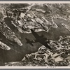 During all of April, Malta, the British stronghold in the Mediterranean, was under a continuous hail of German and Italian bombs.  A German Junkers 88 dive bomber is seen over the naval port of Valetta.]