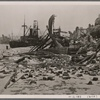 [The fighting in the Crimea was especially fierce.  This is the harbor of Feodosiya after its recapture by German troops following a Stuka attack.]