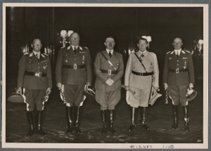 [At a special reception, the Führer presented the Air Force's field marshals with their batons.  Our picture shows (from left): Field Marshal Milch, Field Marshal Sperrle, the Führer, Reichs Marshal Goering and Field Marshal Kesselring.]