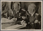 [... a peaceful revision of the Rumanian-Hungarian border.  Our pictures show Reichs Foreign Minister von Ribbentrop presenting the agreement and Rumanian Foreign Minister Manoilescu at the signing.]