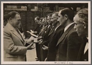 [The homeland also worked at full strength.  Field Marshal Goering was able to present 34 workers with the War Service Cross for speedily putting up buildings for the Air Force under difficult weather conditions.]