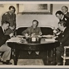 In Berlin the foreign ministers of Estonia and Latvia sign non-aggression pacts with Germany.  From left to right: The Latvian Foreign Minister Munters, Reich Foreign Minister von Ribbentrop and the Estonian Foreign Minister Selters.]