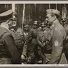 On June 4th Adolf Hitler made a surprise visit to the headquarters of Marshal Mannerheim of Finnland in order to personally deliver his best wishes and those of the German people on the occasion of the Marshal's 75th birthday.  The Fuhrer in conversation with Field Marshal Mannerheim; at left General Field Marshal Keitel; between the two statesmen Reich Press Chief Dr. Dietrich.]